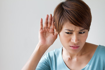 woman suffers from hearing impairment, hard of hearing, hearing