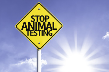 Stop Animal Testing road sign with sun background