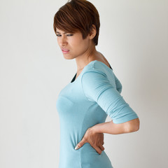 woman suffers from backpain, concept of office syndrome