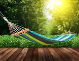 Fototapety Relaxing on hammock in garden