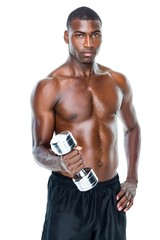 Portrait of a fit shirtless young man lifting dumbbell