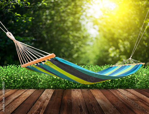 Relaxing on hammock in garden - 68842039