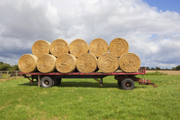 round straw bales and trailer