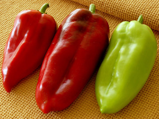 three sweet peppers on napkin