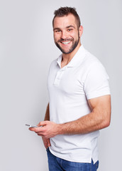 Happy man with phone in hand