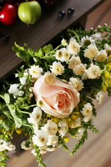 Beautiful bouquet in wooden shelf close up