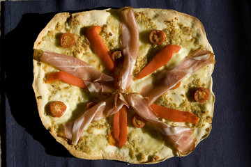 Pizza with tomatoes, pepper, ham top view