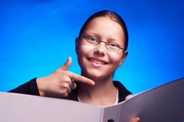 Young student in eyeglasses holds folder and smiling