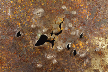 dents from falling bullets in the sheet metal  background