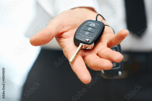Fotografiet Car Keys. Seller hand giving keys