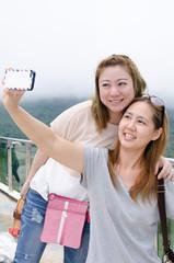 Beautiful young women using a mobile phone. Portrait of asian.