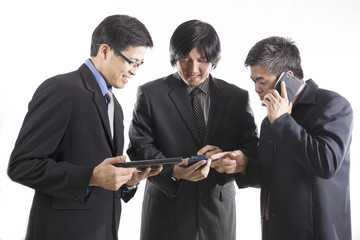 Three Businessman meeting and using mobile phone