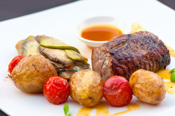 Prime grilled juicy beef steak with roasted vegetables
