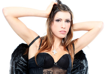 Sensual brunette angel with black wings and underwear