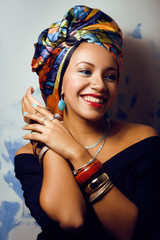 beauty bright african with creative make up, shawl on head like
