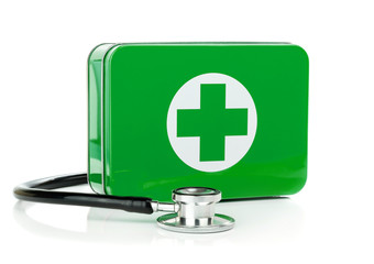 First aid box and stethoscope on a white background