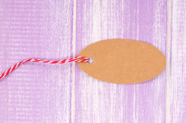 empty tag on purple wooden background