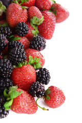 Blackberries and strawberries isolated on white