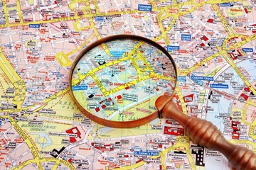 Map of London and magnifier glass.