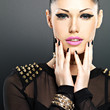 Beautiful face of fashion woman with black nails and bright make