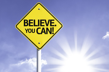 Believe. You Can! road sign with sun background