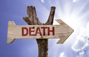 Death wooden sign on a sky background