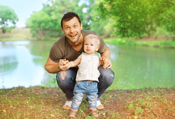 Happy father and child in the summer park