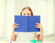 girl studying and reading book at school
