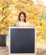 happy little girl with blank blackboard