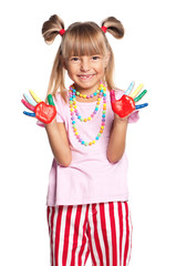 Little girl with paints on hands