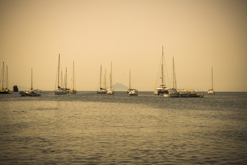 Aeolian sea landscape with yachts in sepia colors