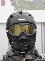 Skiier with face completely covered wearing a helmet and goggles