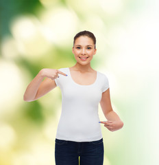 smiling young woman in blank white t-shirt