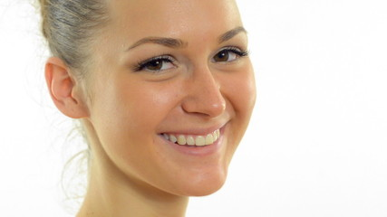 young beautiful woman smiling and looking at the camera