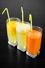 Glasses of fresh carrot, apple and orange juice