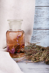 Bottles of herbal tincture and dried herbs