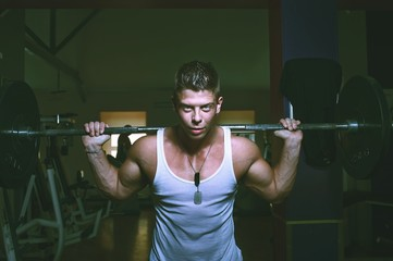 Guy doing exercises with barbell