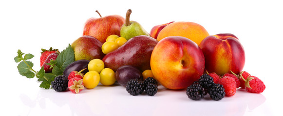 Different berries and fruits isolated on white