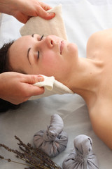 Portrait of relaxed young womangetting spa procedure