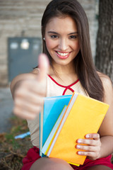 Young female holding books