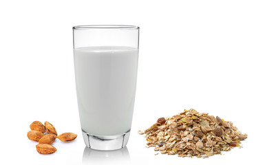 fresh milk in the glass almond and muesli breakfast placed on wh