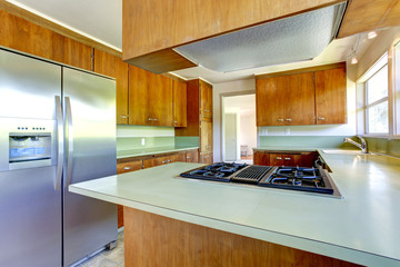 Kitchen cabinets with green tops