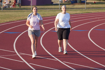 two women walking a track
