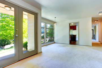 Empty house interior. Living room with door to backyard