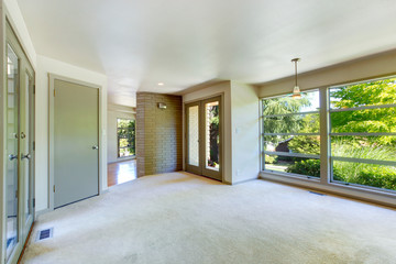 Empty house interior. Living room with glass wall