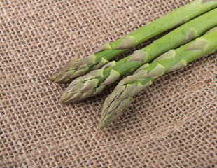 fresh green asparagus sprouts laying on bamboo background
