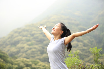 cheering hiking woman open arms mountain peak
