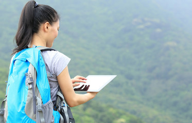 hiking woman use digital tablet mountain peak