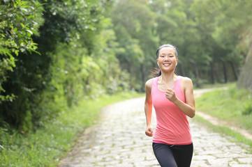 Runner athlete running on forest trail