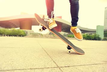 skateboarder legs jumping